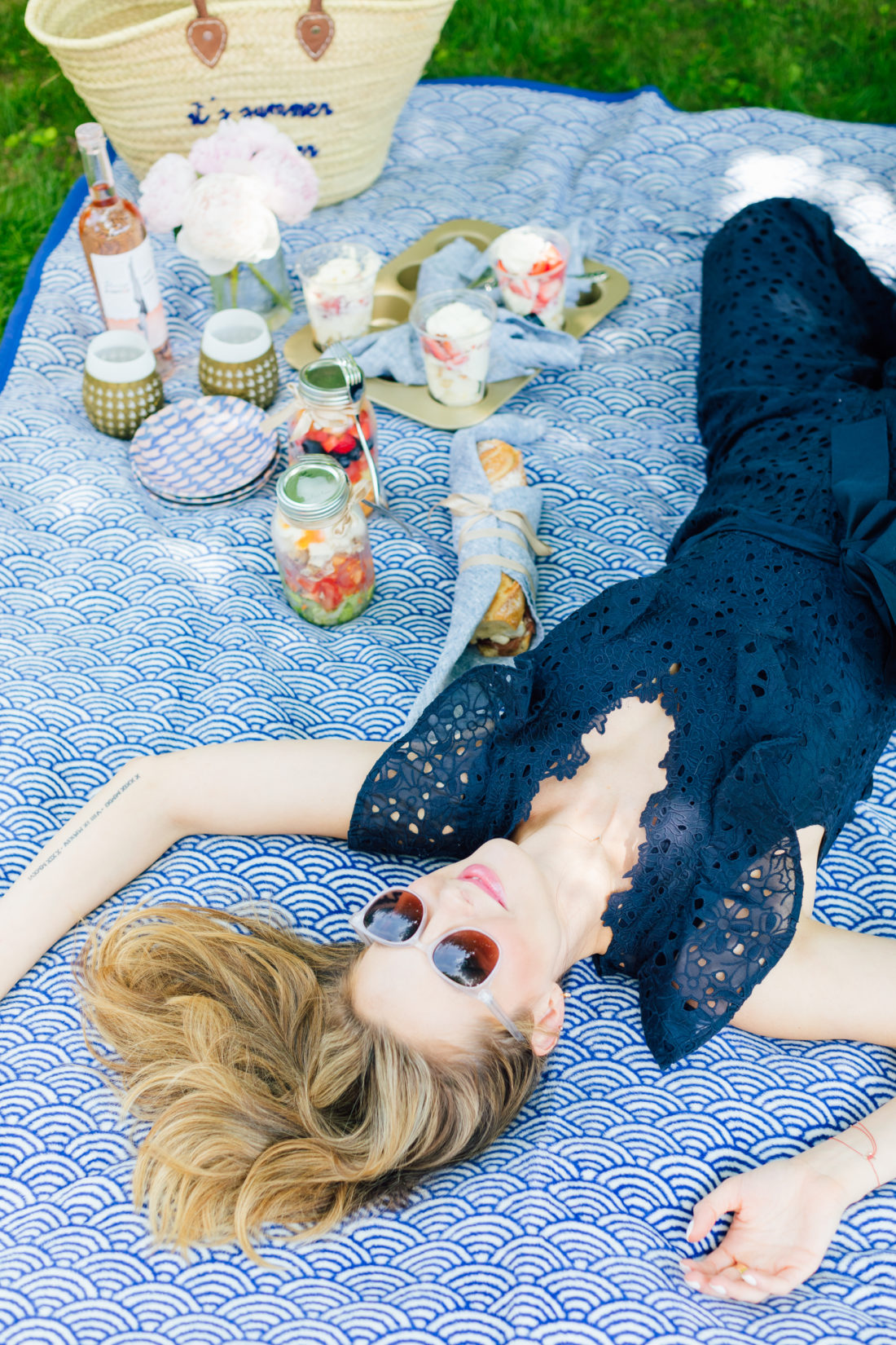 Eva Amurri Martino lies down on a picnic blanket