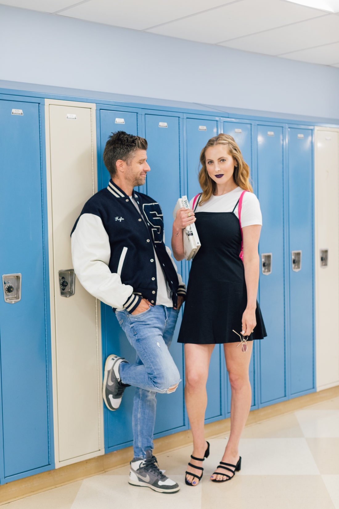 Eva Amurri Martino and husband Kyle wear 90's gear and walk through the halls of his high school