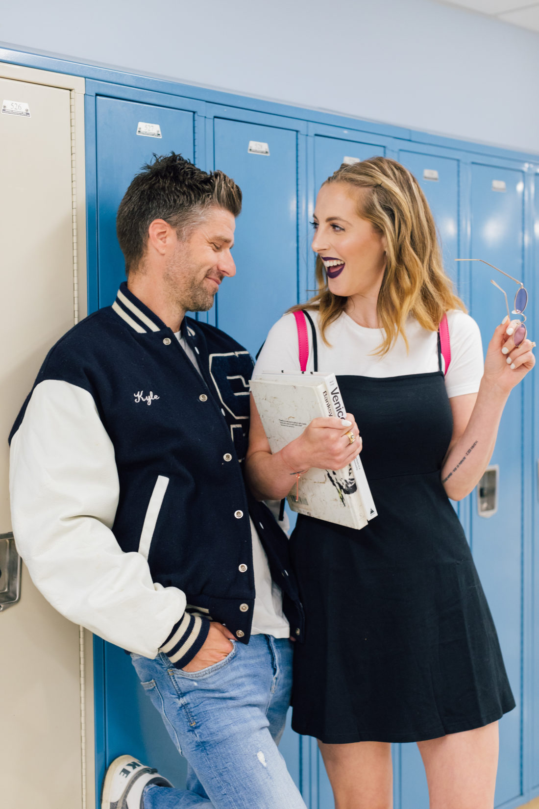 Eva Amurri Martino and husband Kyle wear 90's gear and walk through the halls of his high school