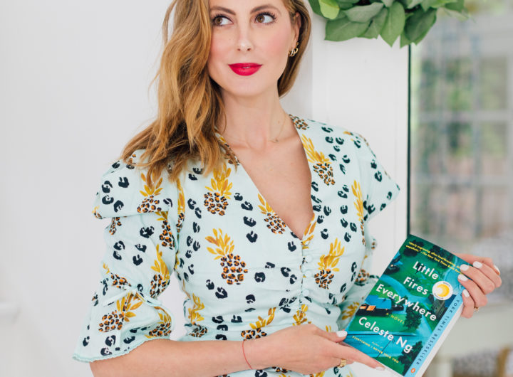 Eva Amurri Martino wears a matching Jonathan Simkhai top and shorts while holding her third HEA Book Club pick: Little Fires Everywhere by Celeste Ng