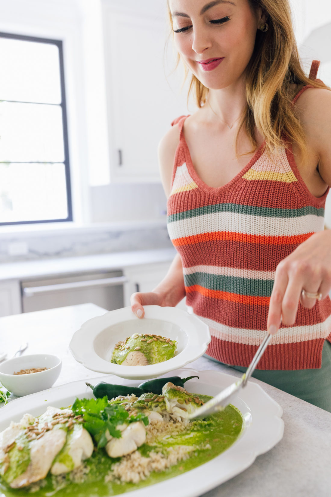 Eva Amurri Martino serves herself some of her Buster's Famous Green Fish