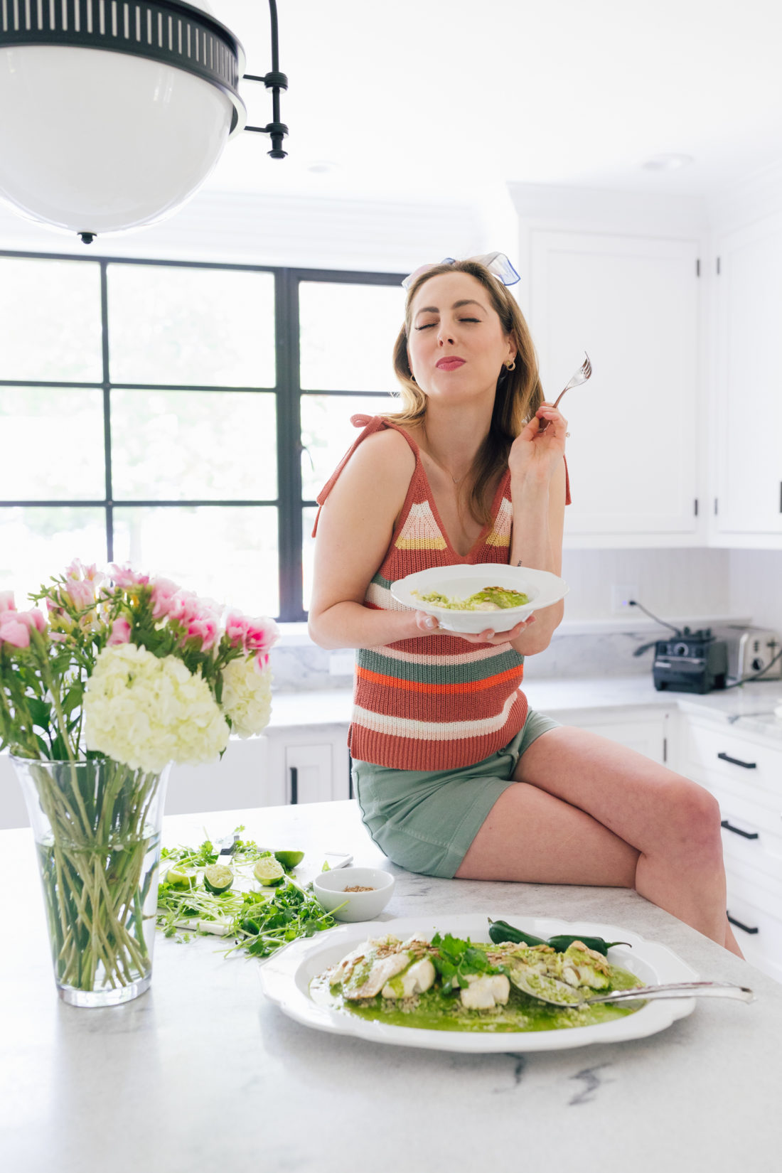 Eva Amurri Martino enjoys her Buster's Famous Green Fish on the kitchen island of her Connecticut home