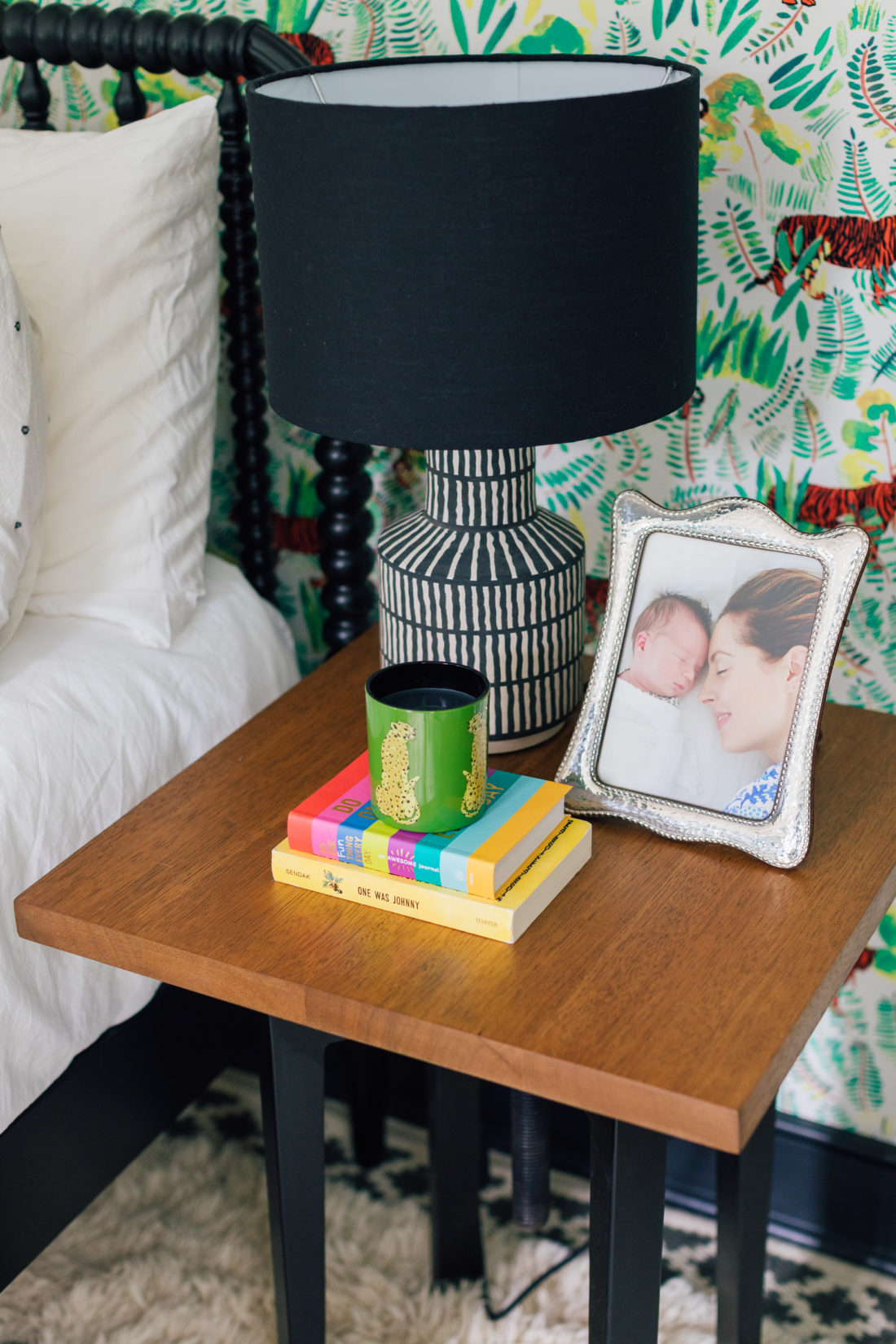 A sweet photos of Eva Amurri Martino with son Major right after his birth sits atop a wooden bedside table in his colorful new bedroom.
