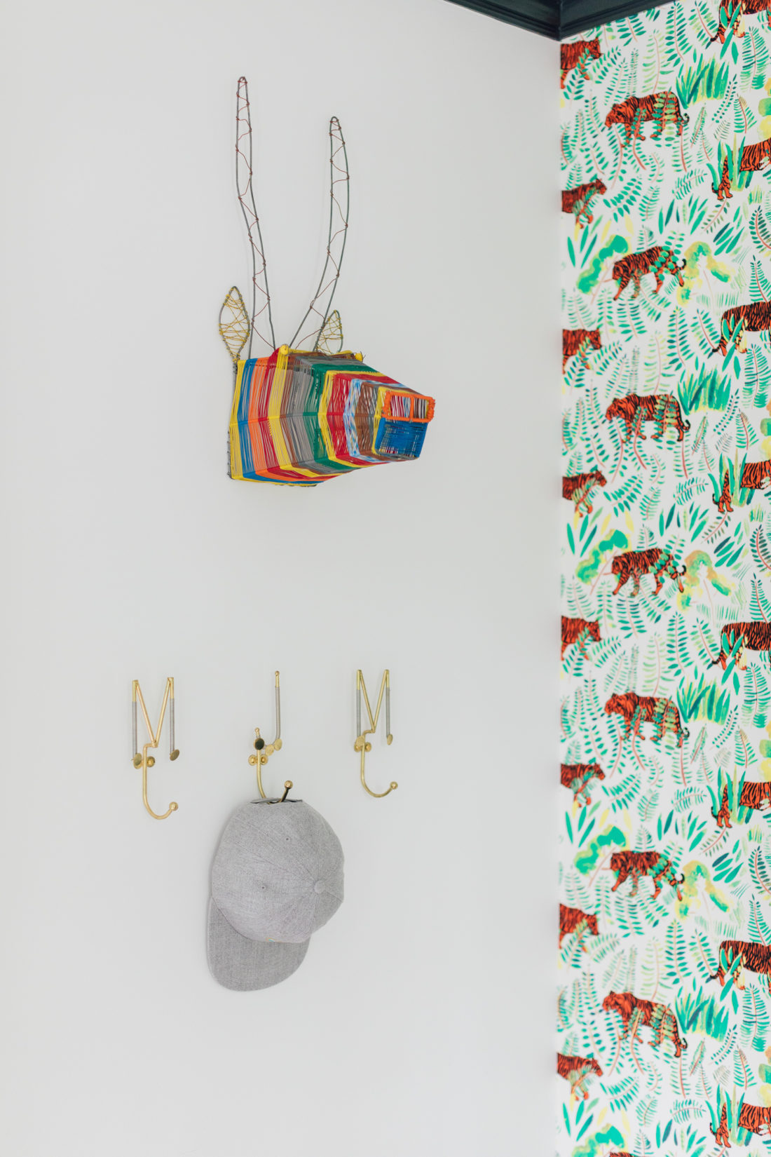 A colorful wall hanging with initial hooks in Eva Amurri Martino's son Major's new room