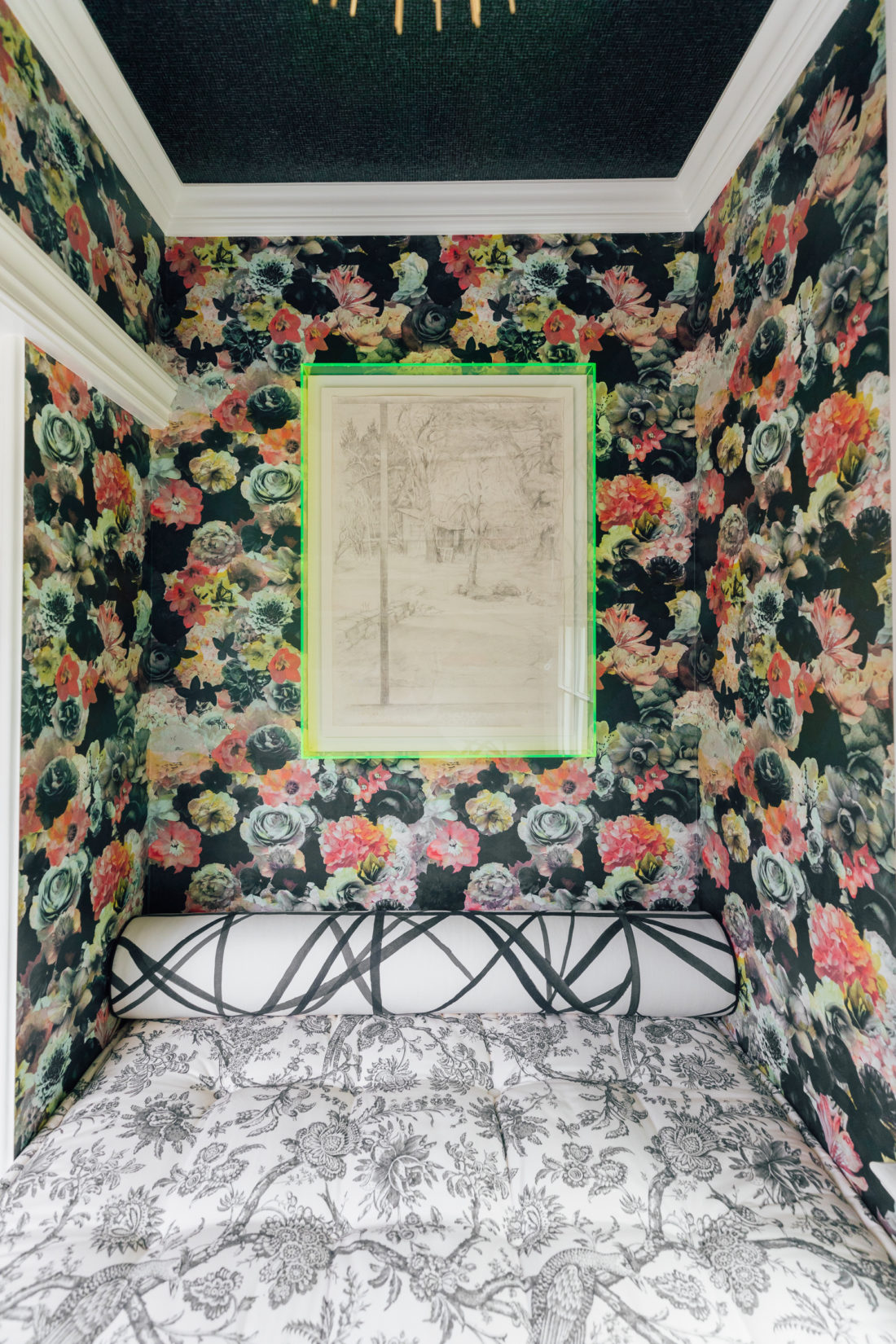 A historic painting framed in a green neon acrylic frame in the snuggle nook of Eva Amurri Martino's Connecticut home