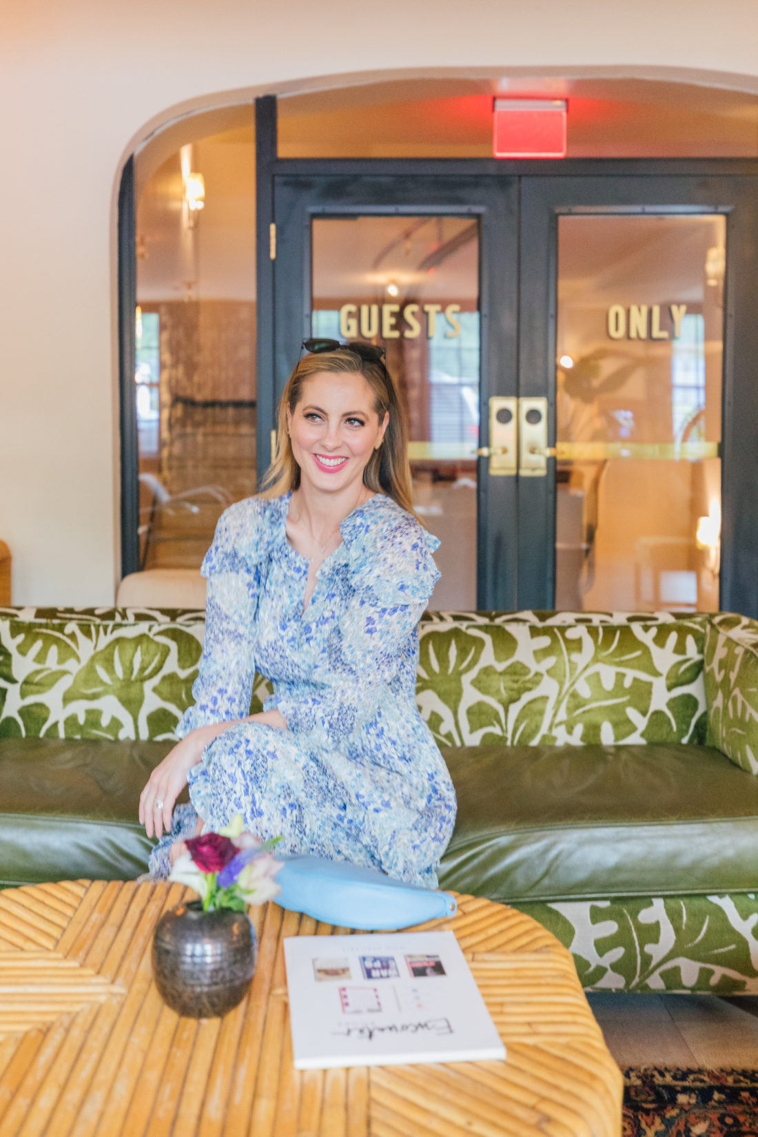 Eva Amurri Martino sits in a floral dress at Clermont Hotel