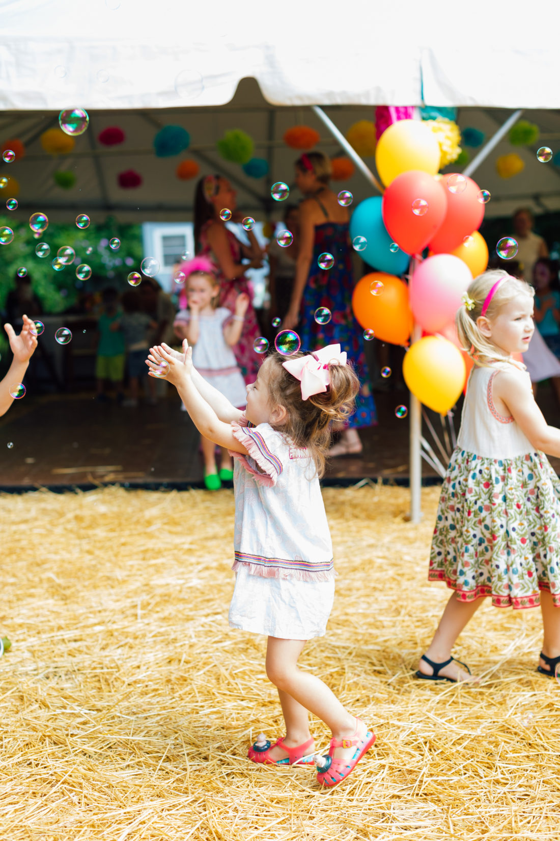Children play with bubbles at Marlowe Martino's El Cinco de Marlowe themed 5th birthday fiesta