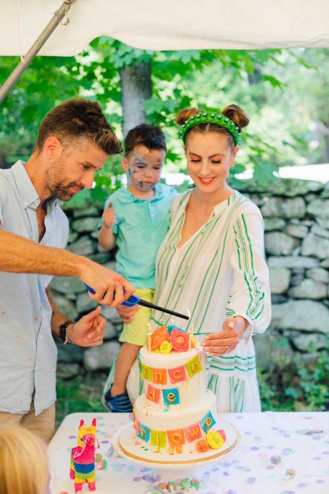 Kyle Martino lights daughter Marlowe's birthday cake at her Cinco de Marlowe themed 5th birthday fiesta