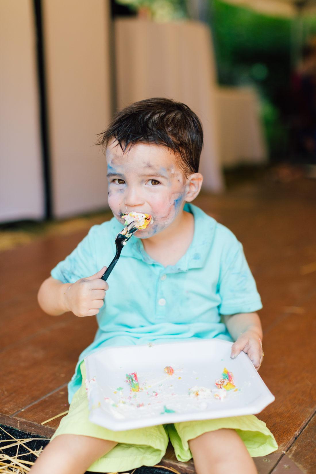 Major Martino enjoys birthday cake at his sister Marlowe's Cinco de Marlowe themed 5th birthday fiesta