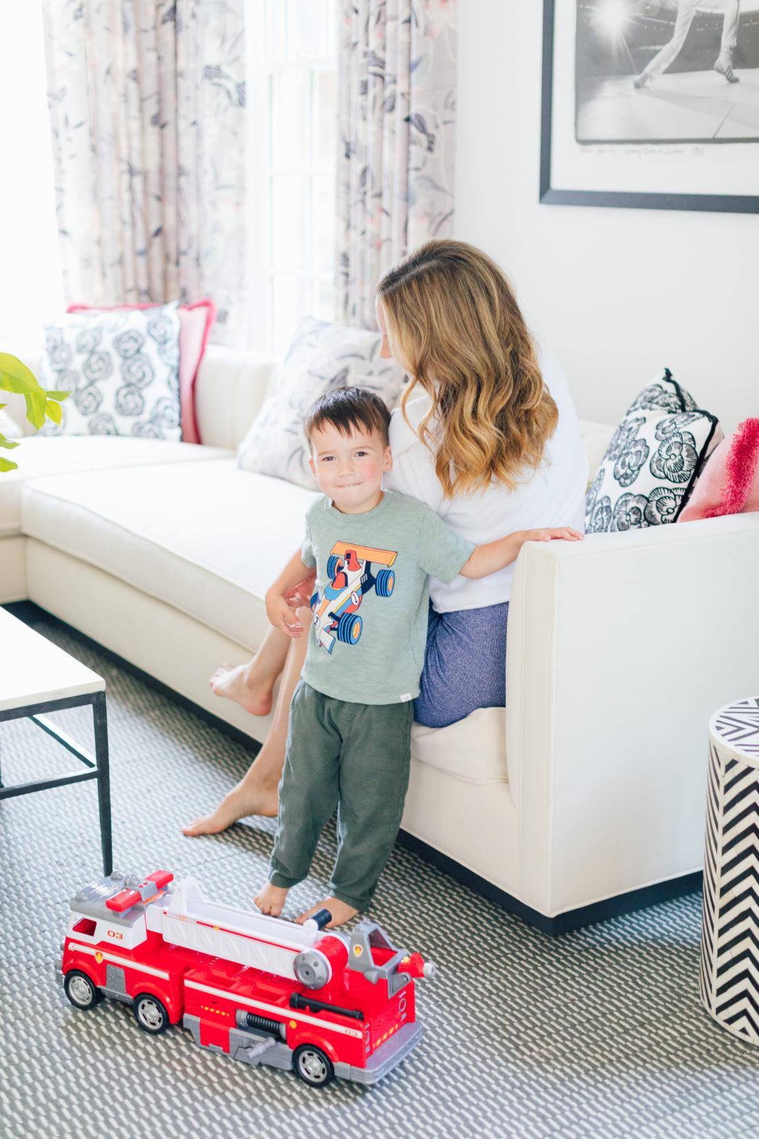 Eva Amurri Martino plays with son Major in a rainbow sweatshirt showing off her easy pretty curls