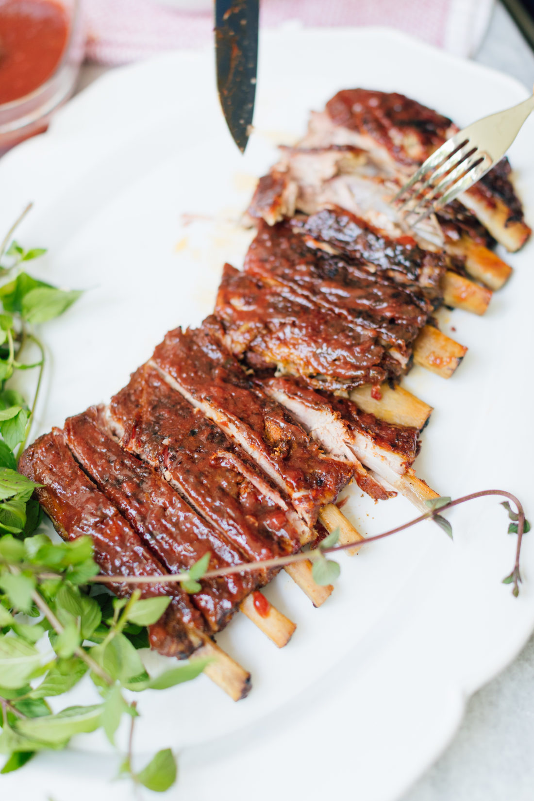 Eva Amurri Martino cuts her rack of ribs on a serving dish