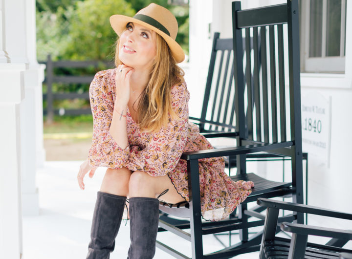 Eva Amurri Martino sits on a rocking chair on her front porch wearing her first fall boots purchase of the season