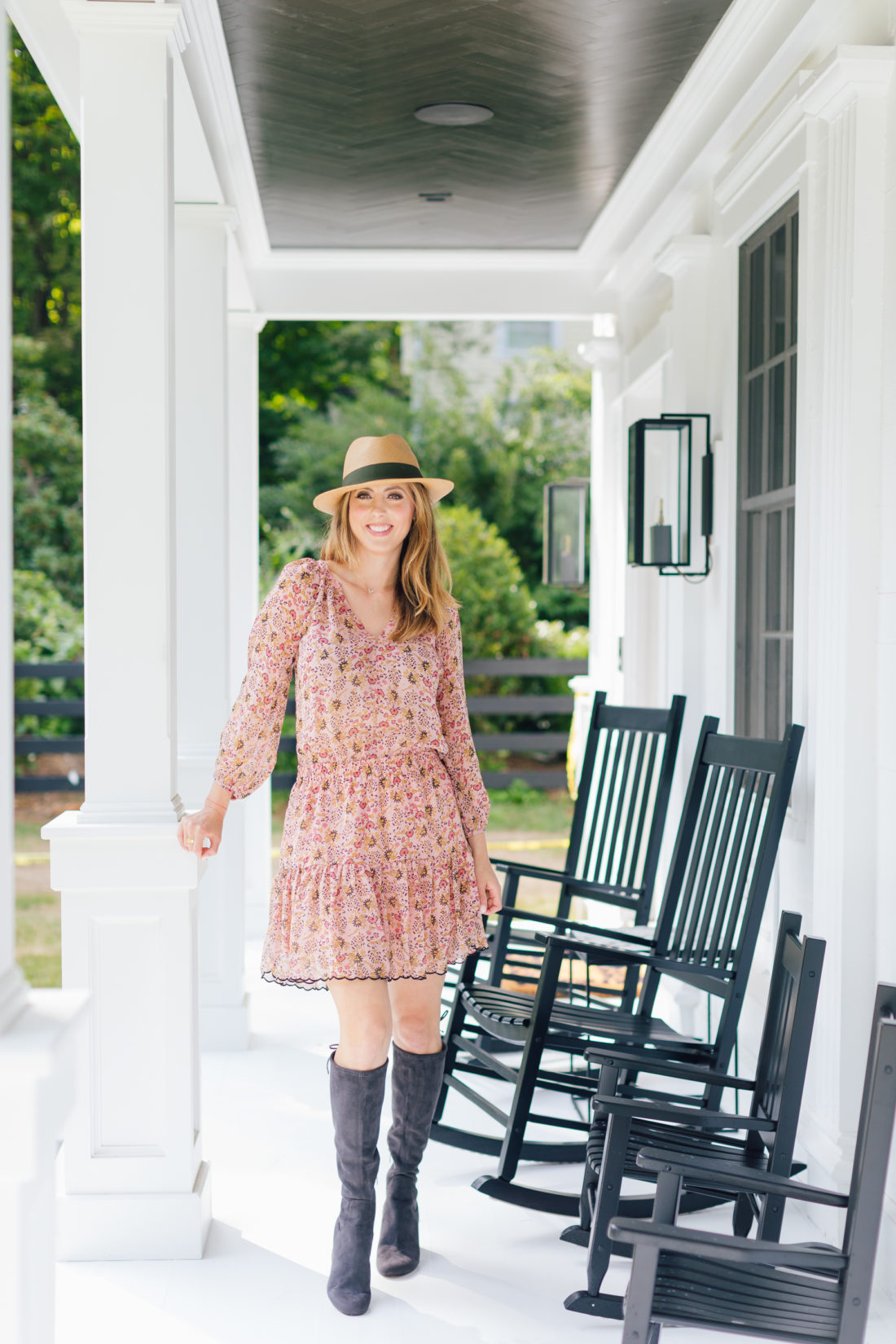 Eva Amurri Martino stands on her front porch wearing her first fall boots purchase of the season