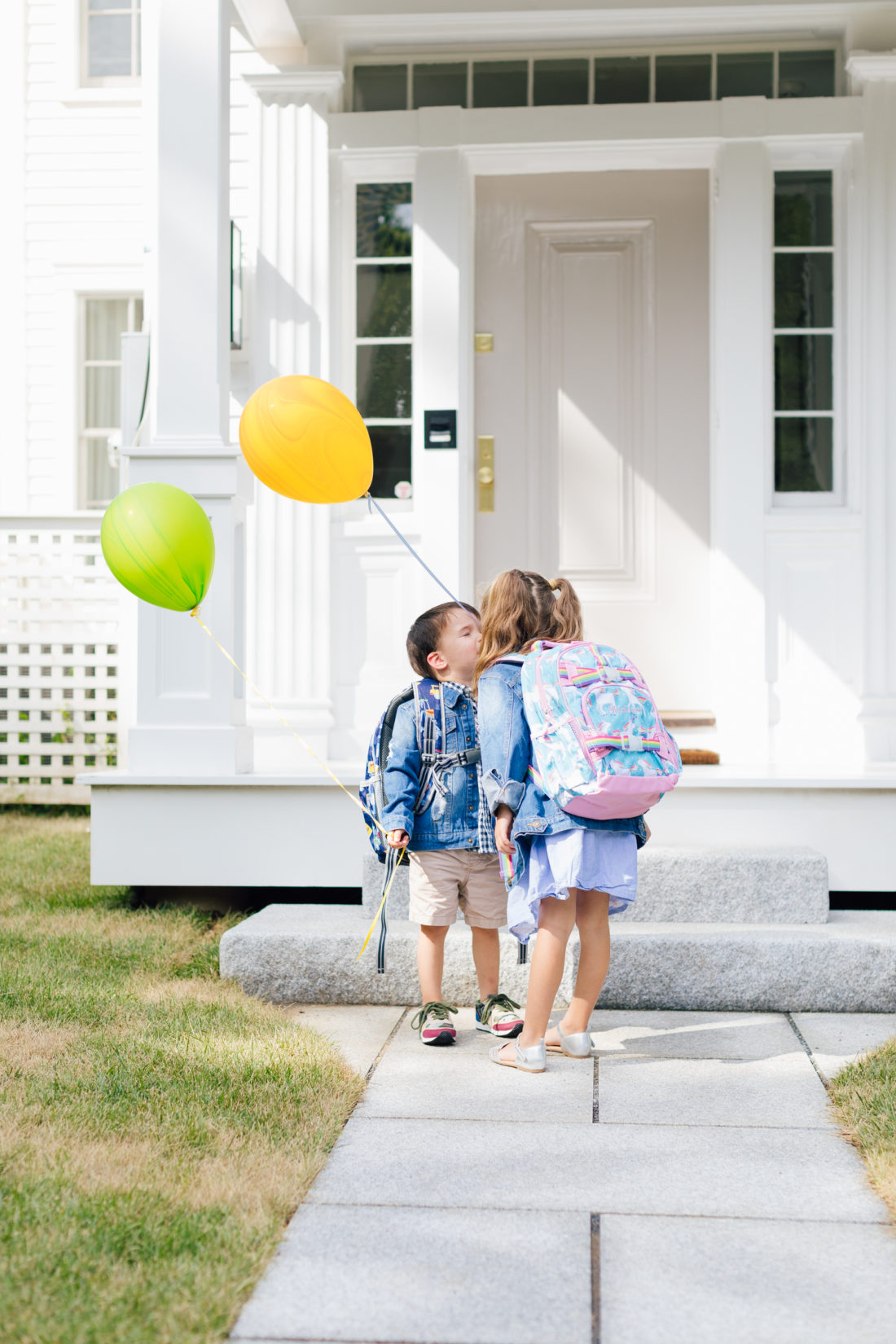 Marlowe Martino kisses her brother Major in their back to school backpacks