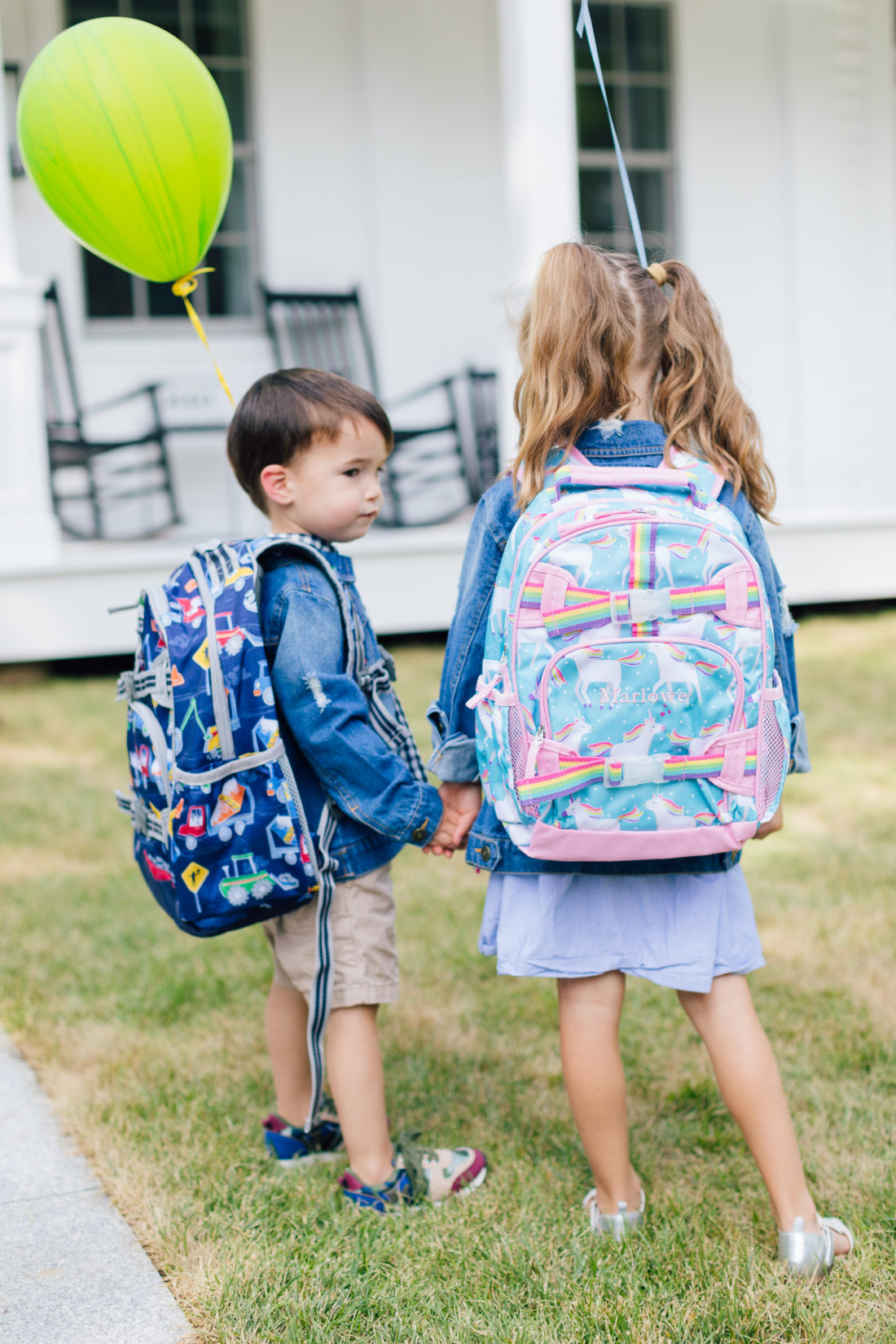 Marlowe and Major Martino holding hands in their back to school gear