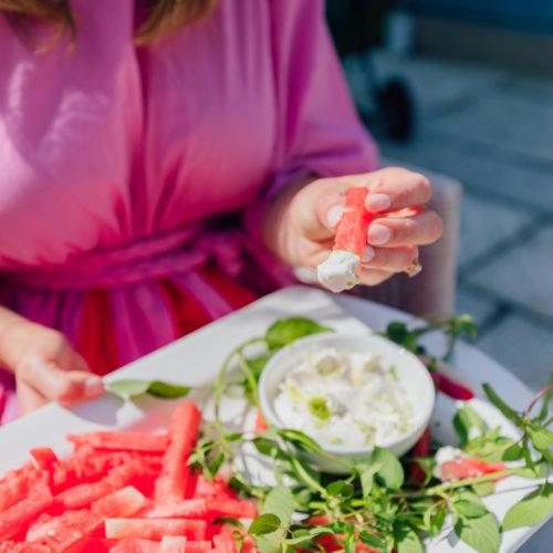 Eva Amurri Martino dips a watermelon fry into a yogurt dip
