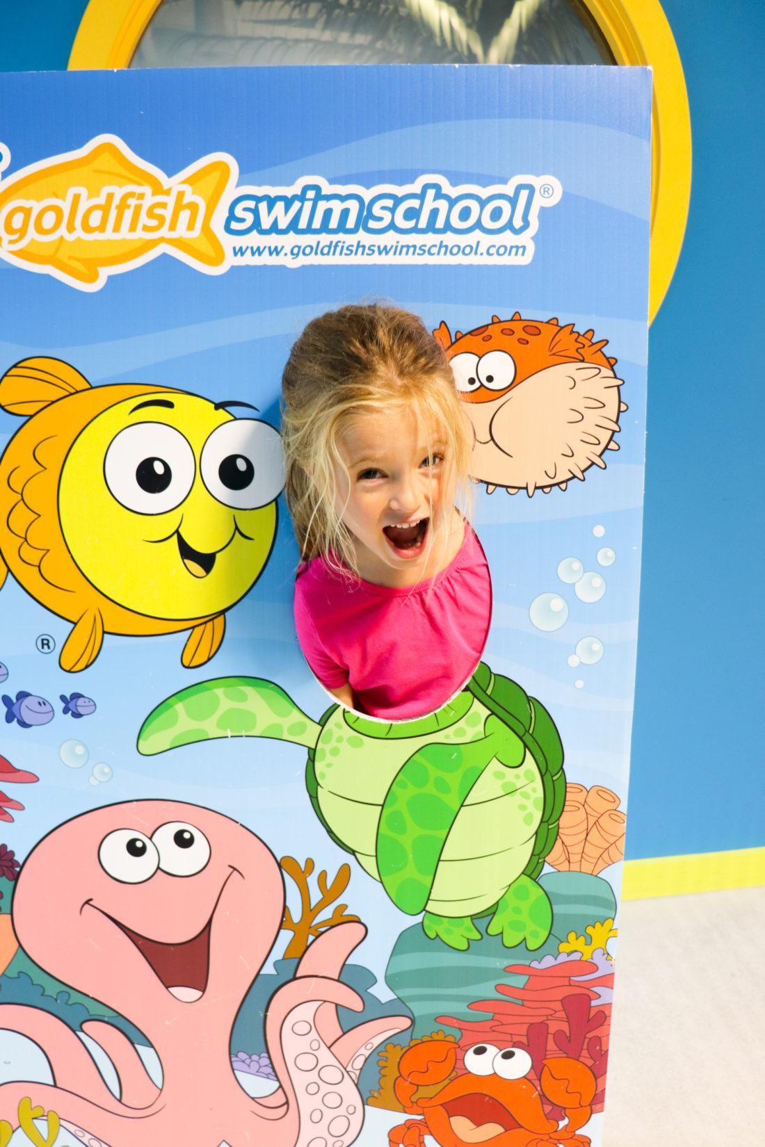 Marlowe Martino posing at her local swim school Goldfish Swim School