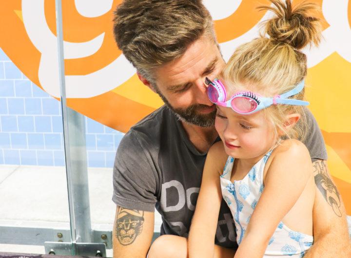 Kyle Martino holds daughter Marlowe before she has swim lessons at Goldfish Swim School