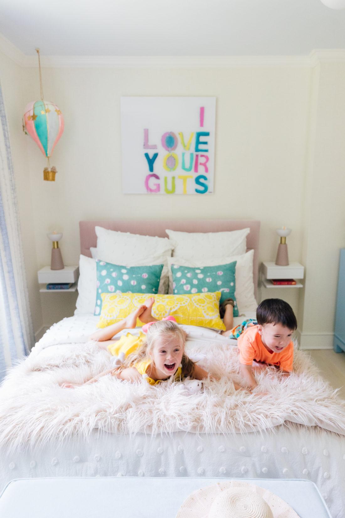 Marlowe and Major Martino jump around Marlowe's new colorful bedroom