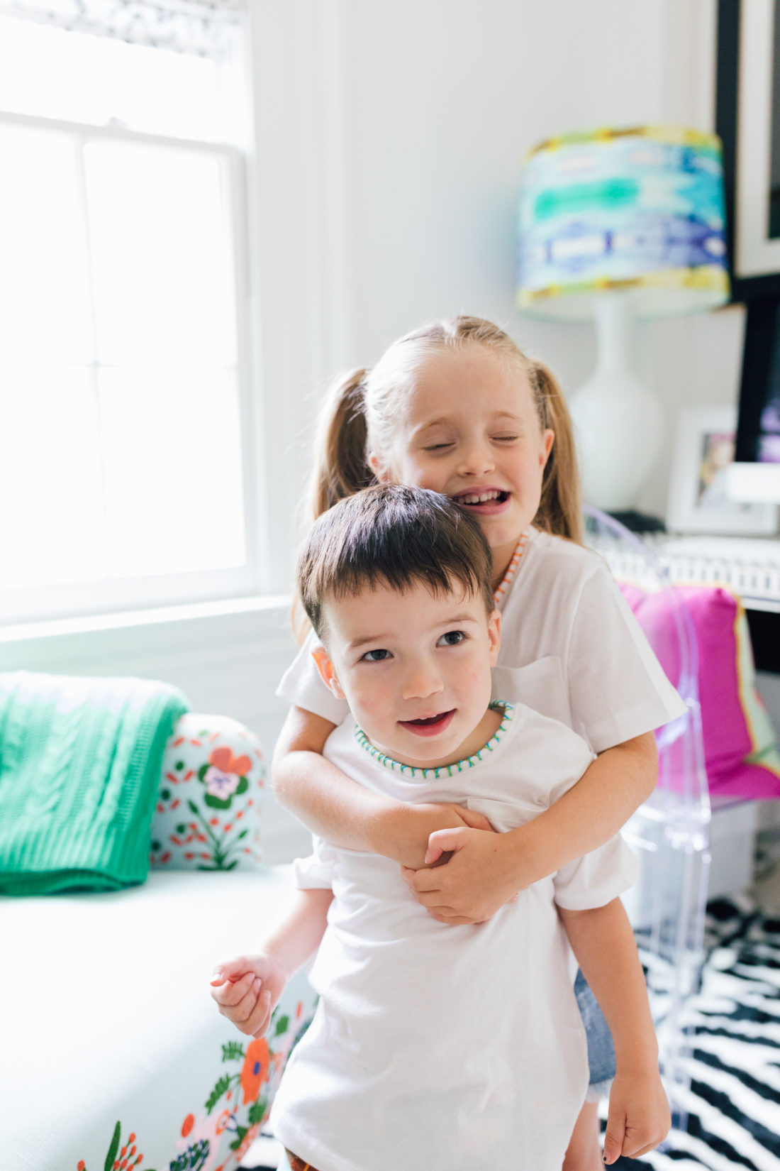 Marlowe and Major Martino hug in their embroidered tees made by mom Eva Amurri Martino