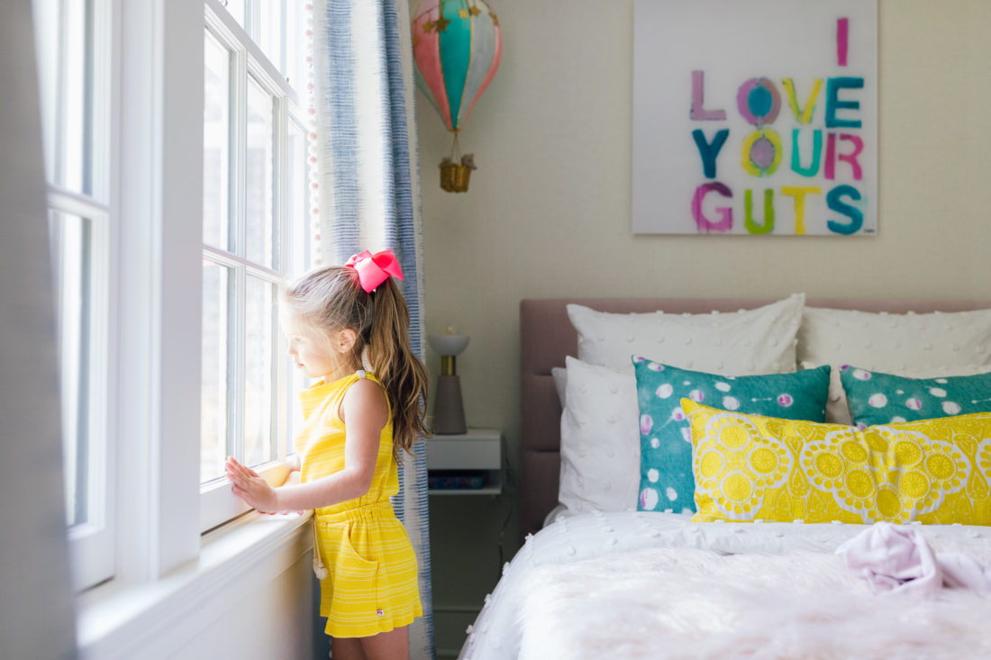 Marlowe Martino looks out the window of her colorful new bedroom
