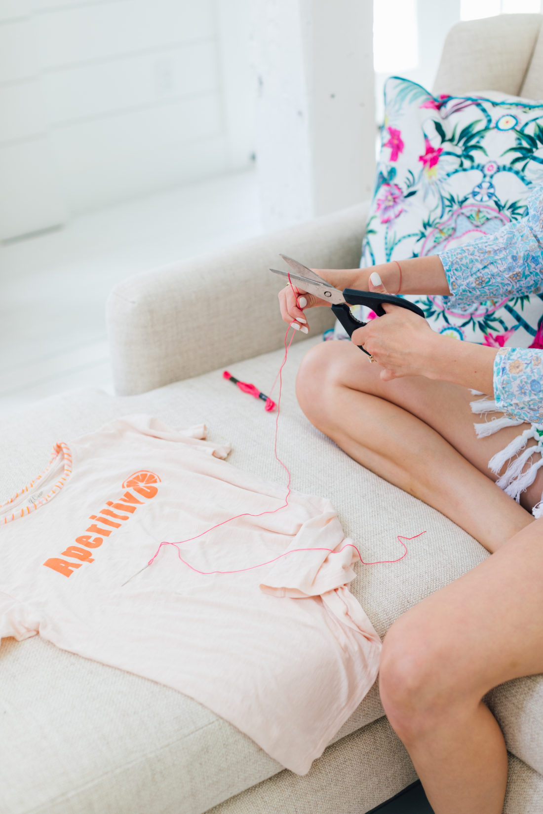 Eva Amurri Martino cutting thread for her embroidered tee DIY