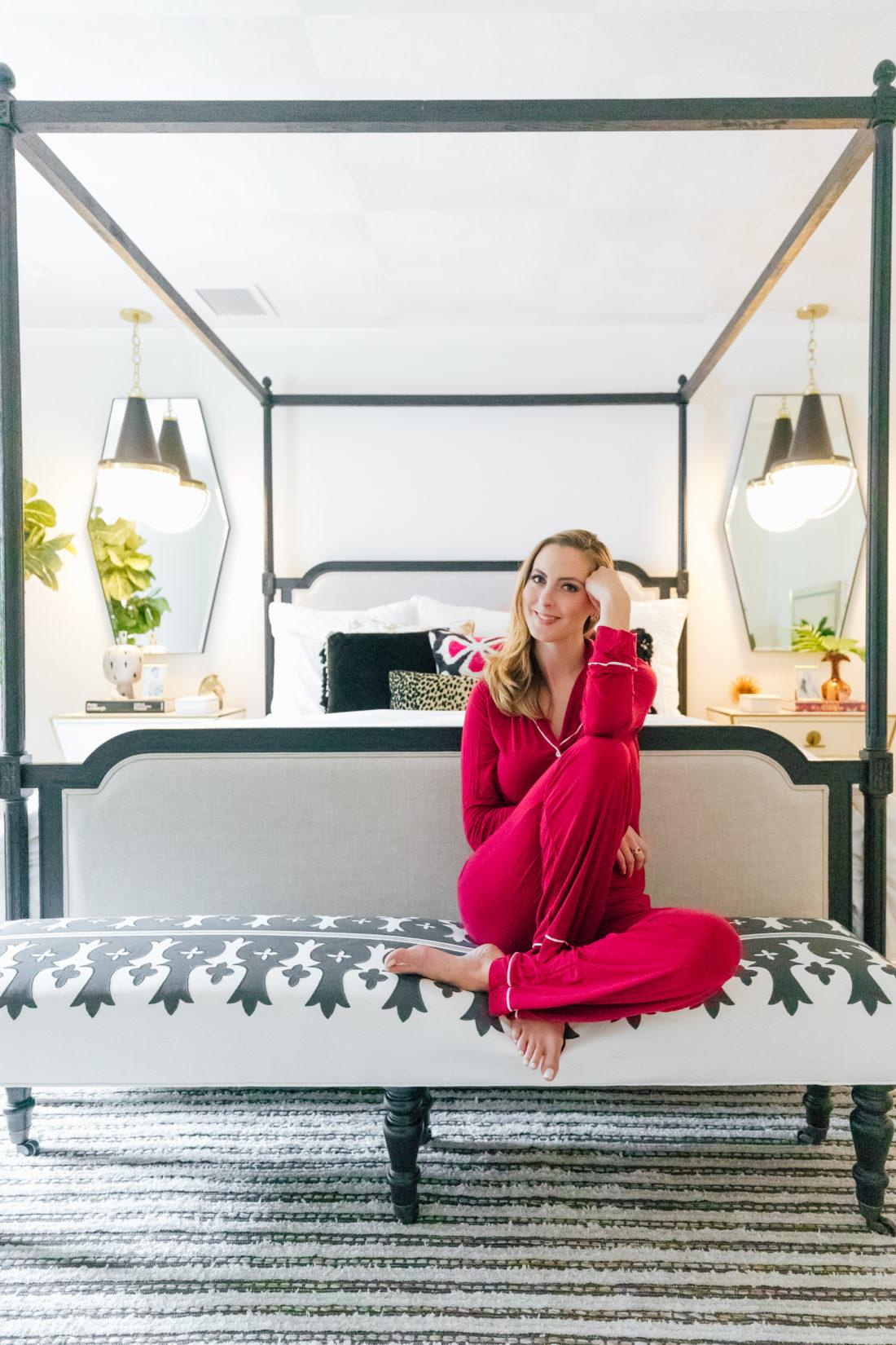 Eva Amurri Martino wears red pajamas while sitting inside her new master bedroom