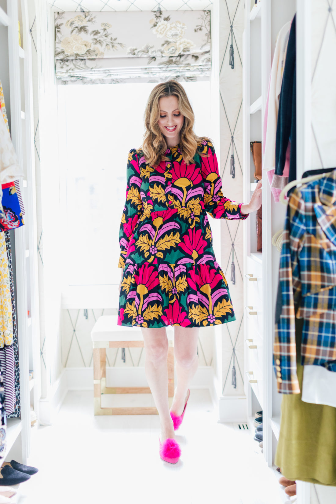 Eva Amurri Martino wears a colorful dress inside her walk-in closet