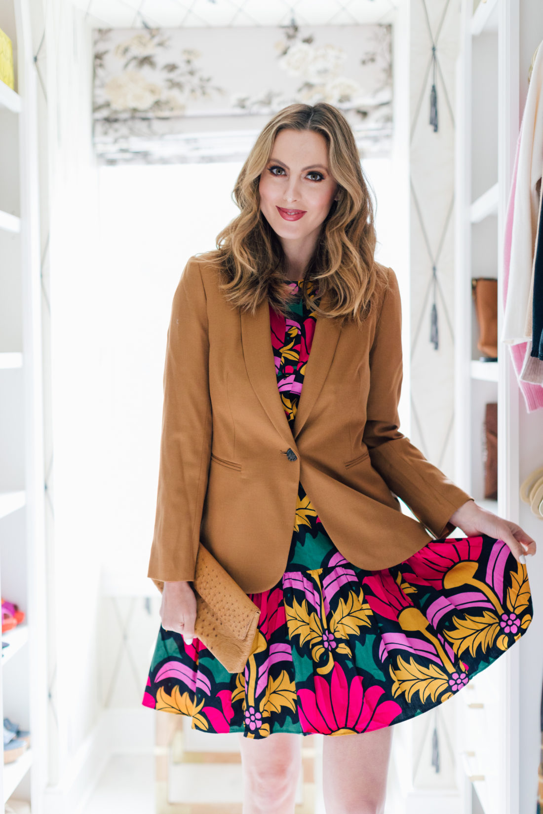 Eva Amurri Martino wears a colorful dress under a fall blazer inside her walk-in closet