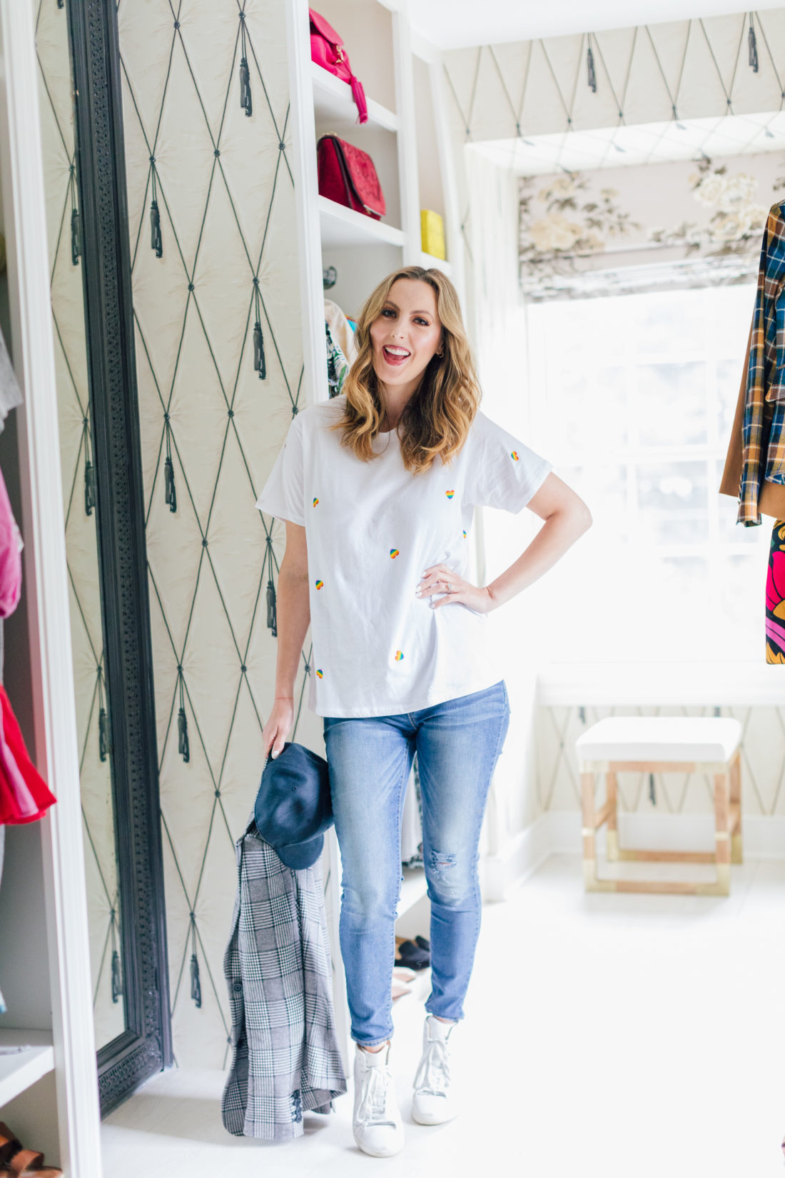 Eva Amurri Martino wears a simple white tee and jeans before styling it with a plaid blazer