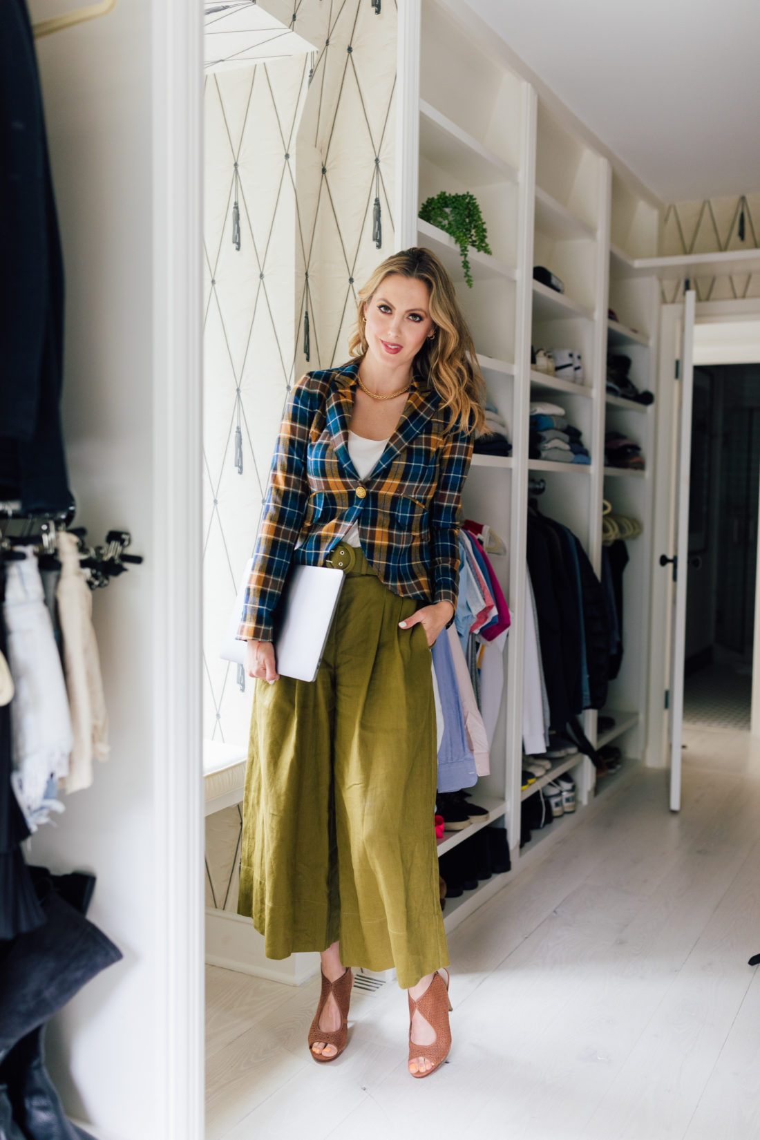Eva Amurri Martino wears a plaid blazer in her walk-in closet