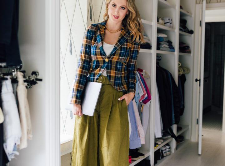 Eva Amurri Martino wears a plaid blazer in her walk-in closet
