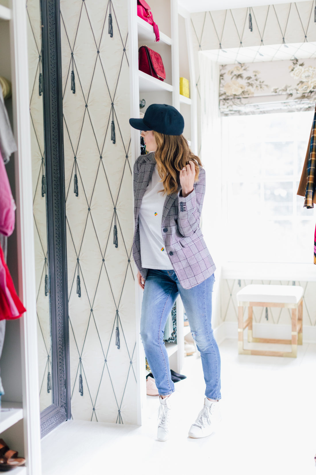 Eva Amurri Martino wears a fall blazer in her walk-in closet
