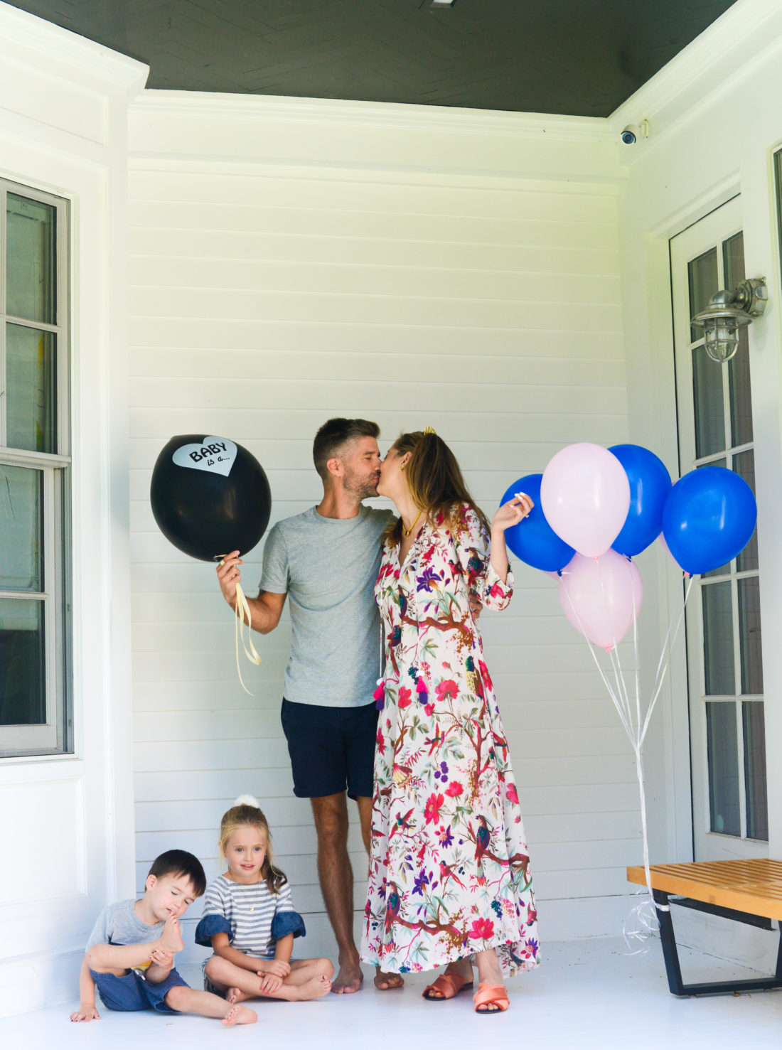 Eva Amurri Martino and husband Kyle hold a balloon with the gender of their third child