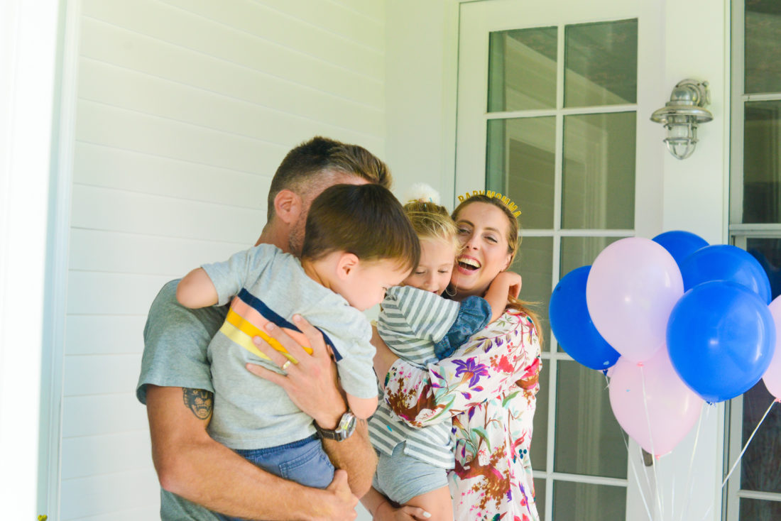 The Martino family embraces after finding out the gender of their third baby
