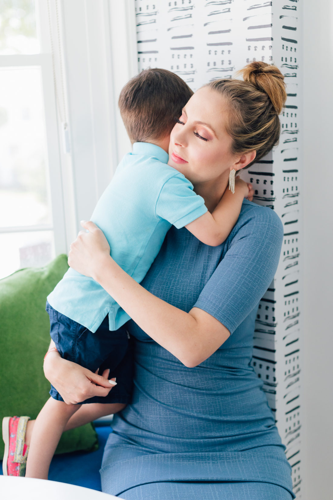 Pregnant Eva Amurri Martino hugs her son Major after surprising her kids with her third pregnancy