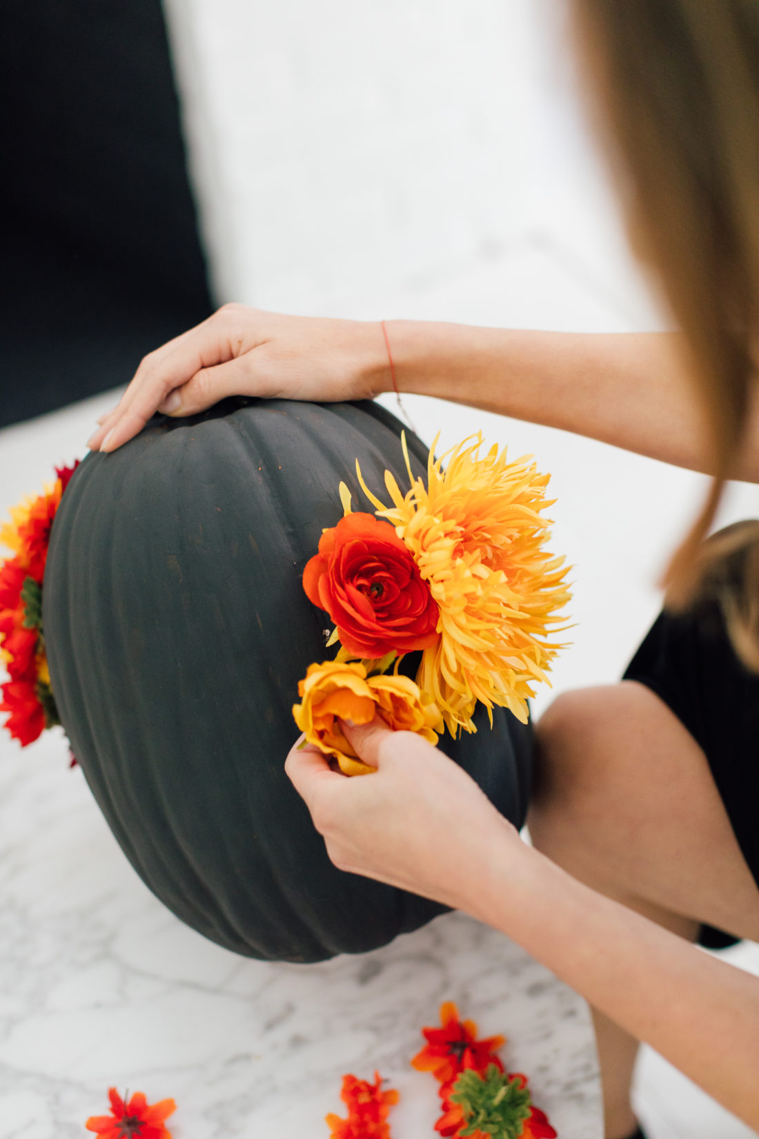 Eva Amurri Martino puts the finishing touches on her DIY faux floral pumpkins