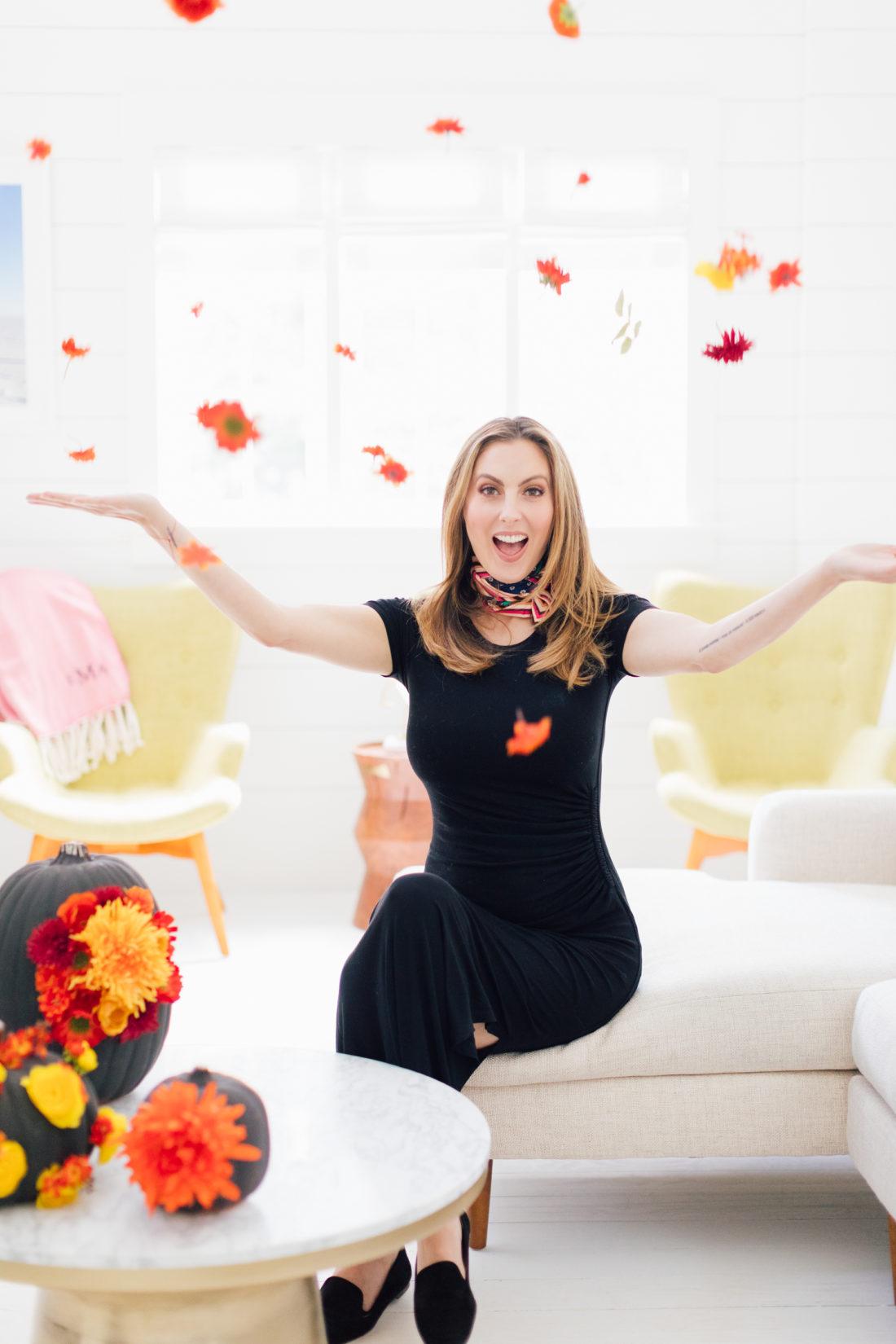 Eva Amurri Martino throws faux flowers in the air