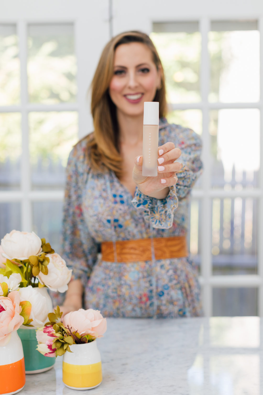 Eva Amurri Martino holds the Fenty Pro Filt'r Foundation as part of her Eva's Obsessions October 2019