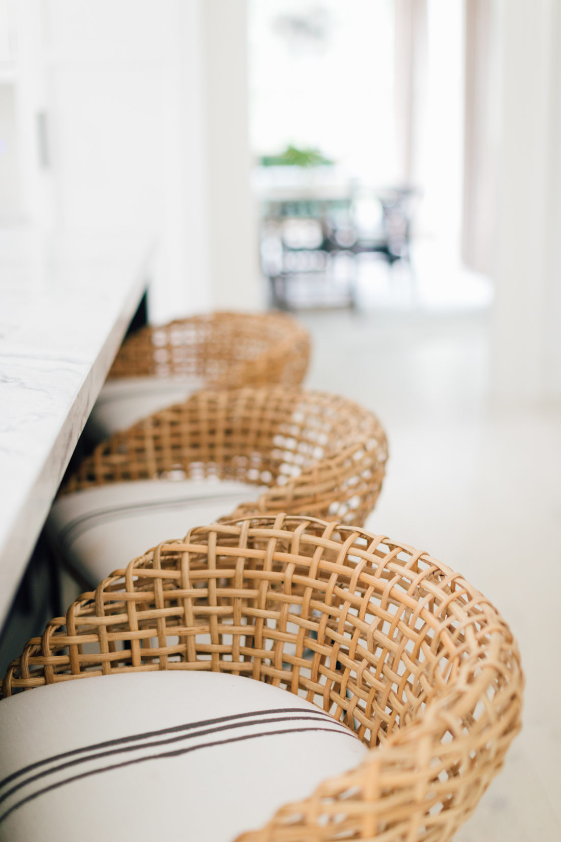 A closeup shot of the woven bar stools and the kerri rosenthal fabric on the bar stools in Eva Amurri Martino's Connecticut kitchen