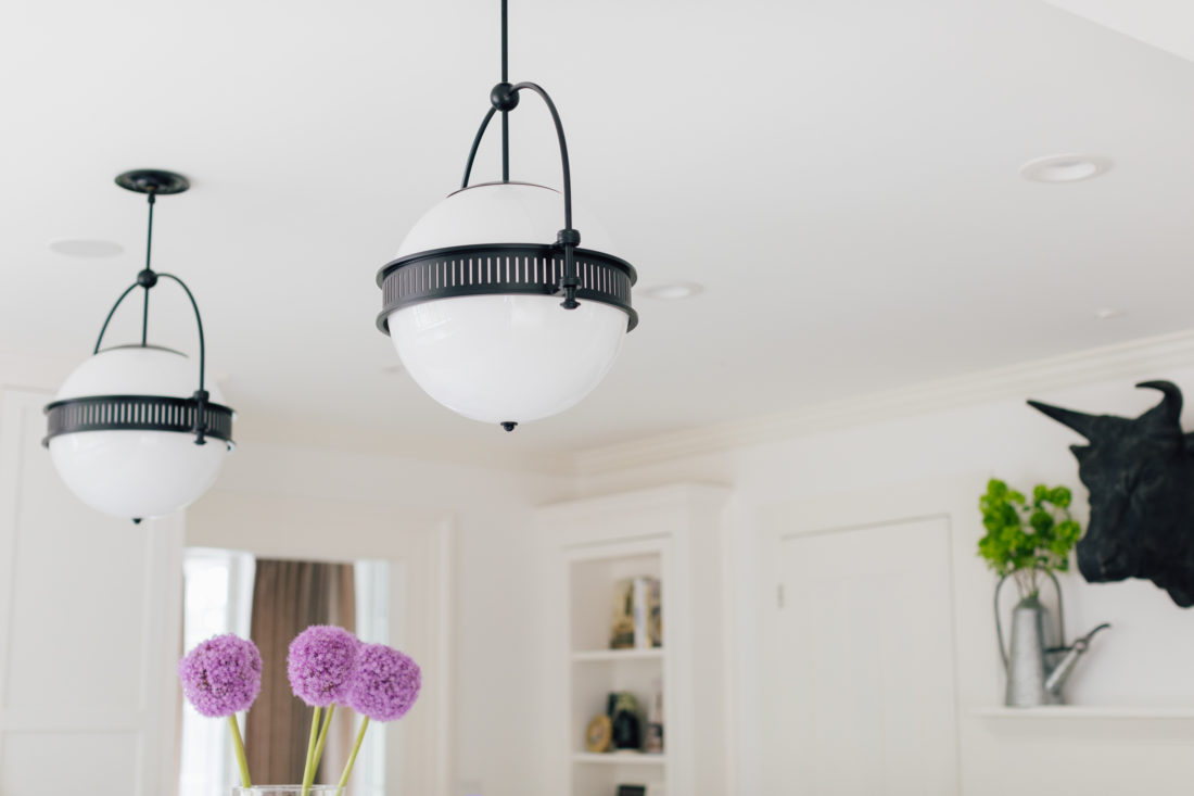 A detail shot of the light fixtures over the island in Eva Amurri Martino's renovated Connecticut home