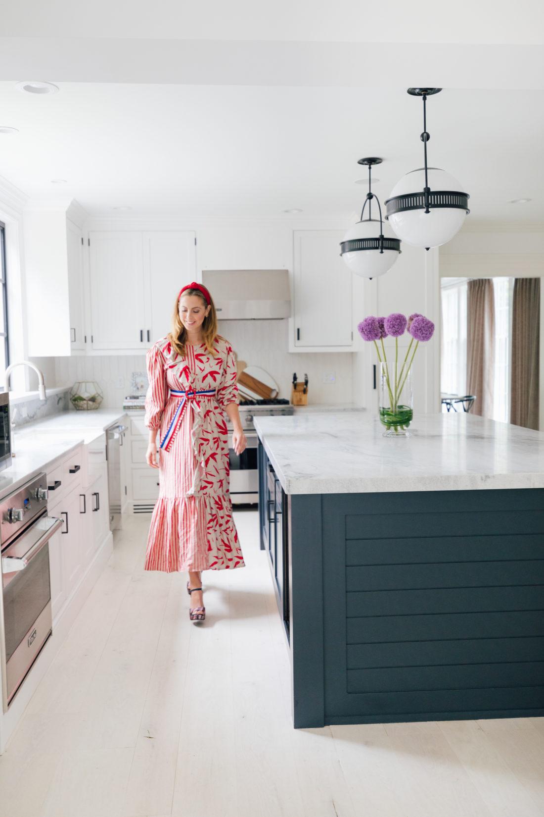 Eva Amurri Martino walks in the kitchen of her renovated Connecticut home