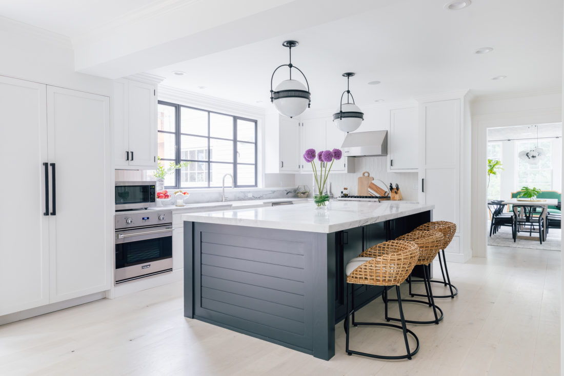 Eva Amurri Martino shares her renovated kitchen in her historic home in Connecticut, featuring a large marble island and a monochromatic color scheme