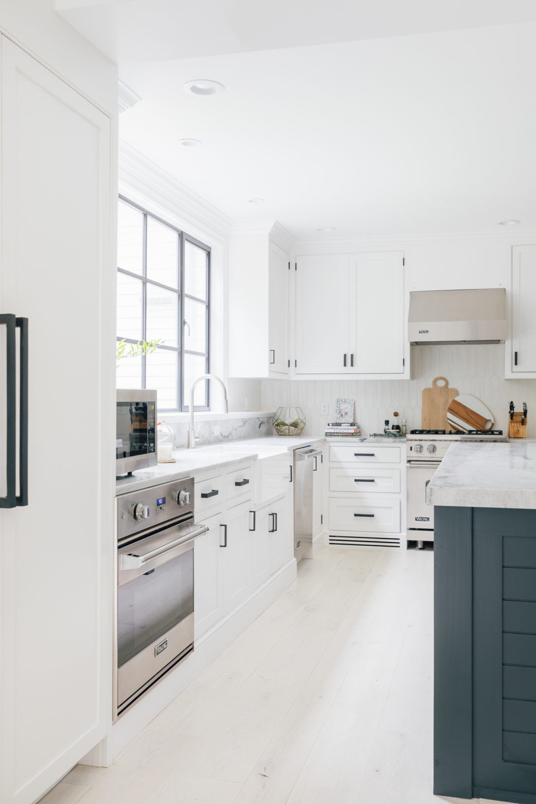 Eva Amurri Martino shares her renovated kitchen in her historical Connecticut home, featuring an open plan and a modern look