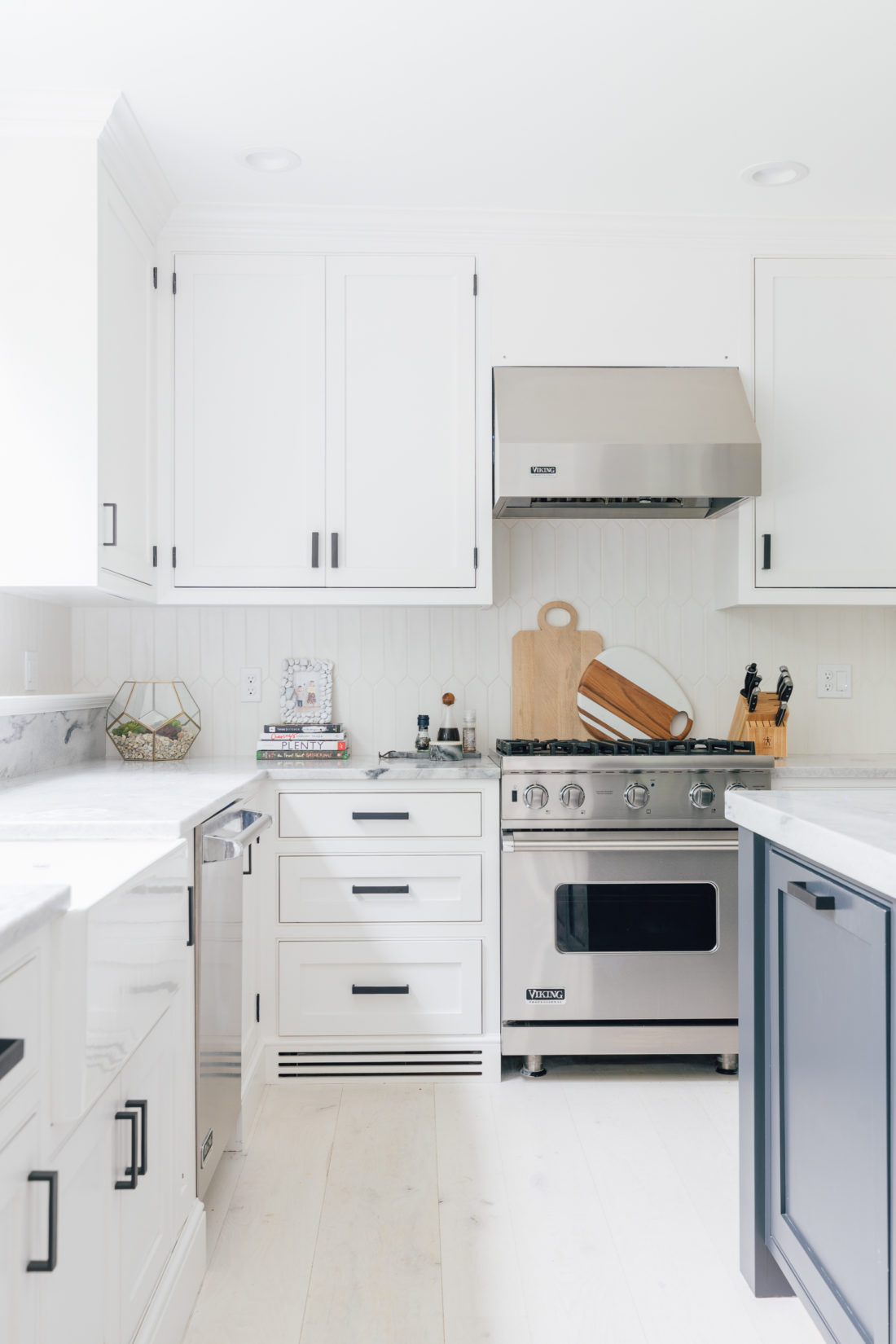 Eva Amurri Martino's renovated historical home features a white and bright kitchen with top of the line appliances and a large center island
