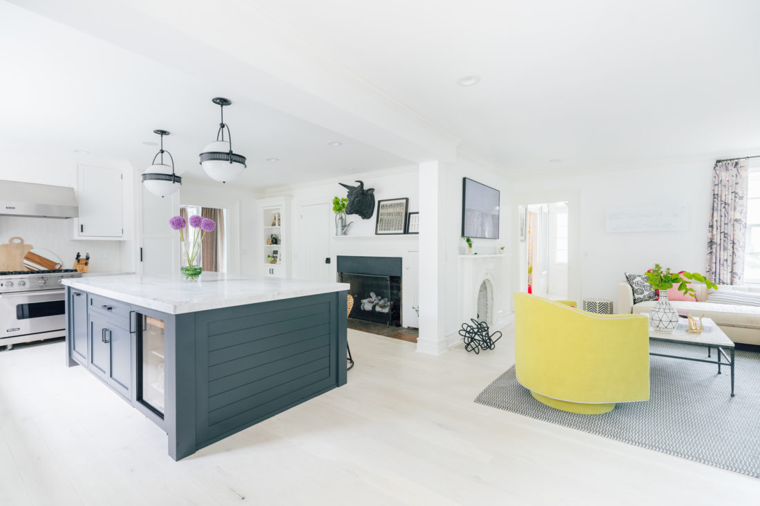 A wide view of Eva Amurri Martino's renovated Connecticut kitchen shows the open plan and the modern and bright style