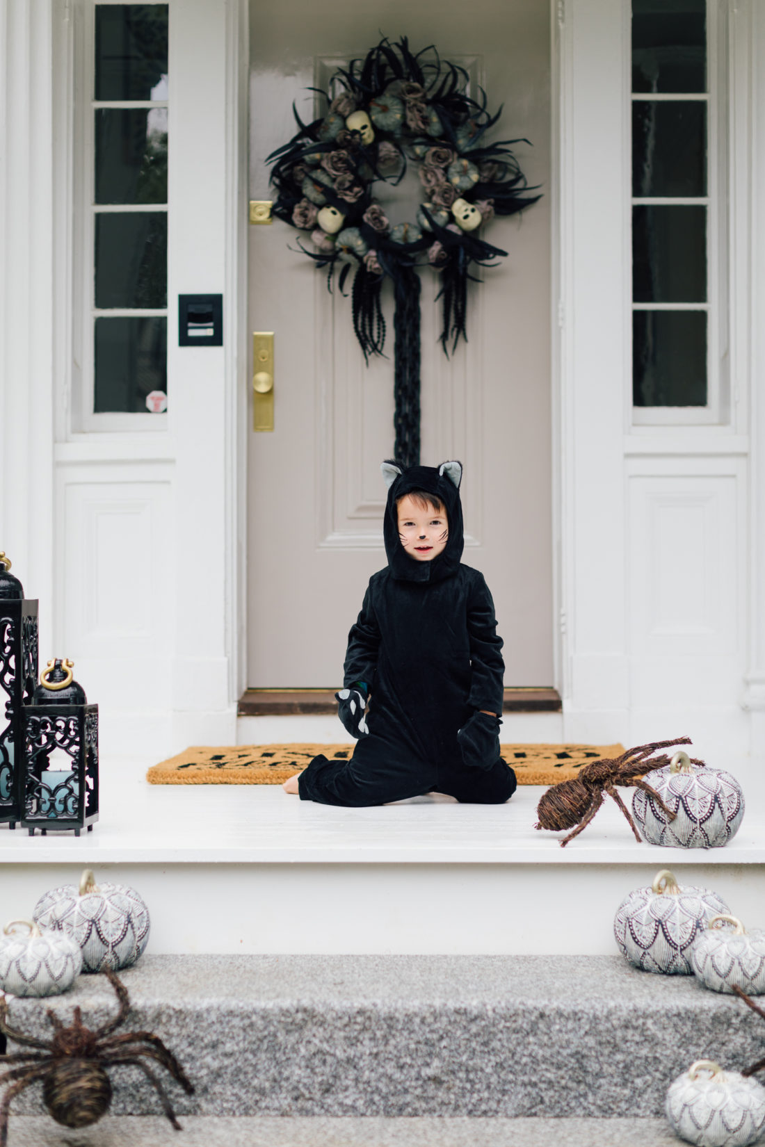 Major Martino wears a cat costume and sits on the front porch of his Connecticut home