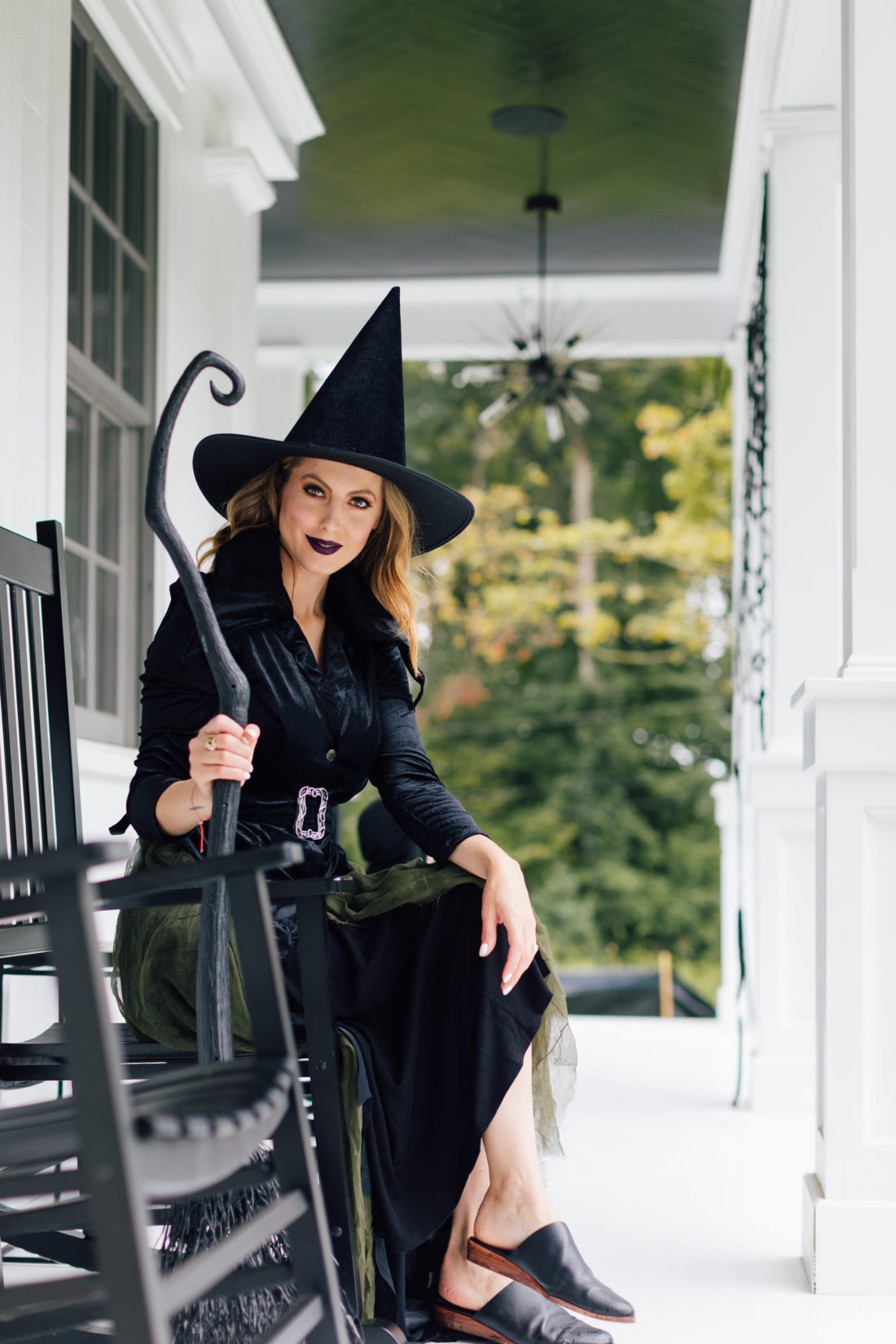 Eva Amurri Martino sits on her front porch amongst the Halloween decorations