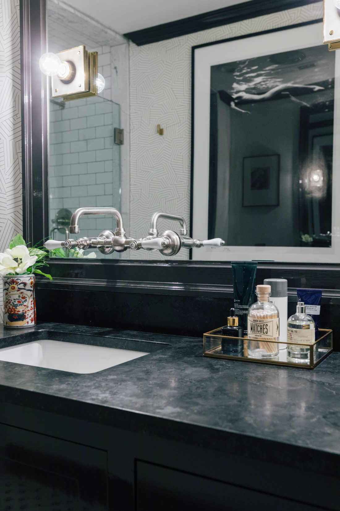 The Saint Henry Black granite countertop from Polycor inside Kyle Martino's masculine bathroom in his newly renovated Connecticut home