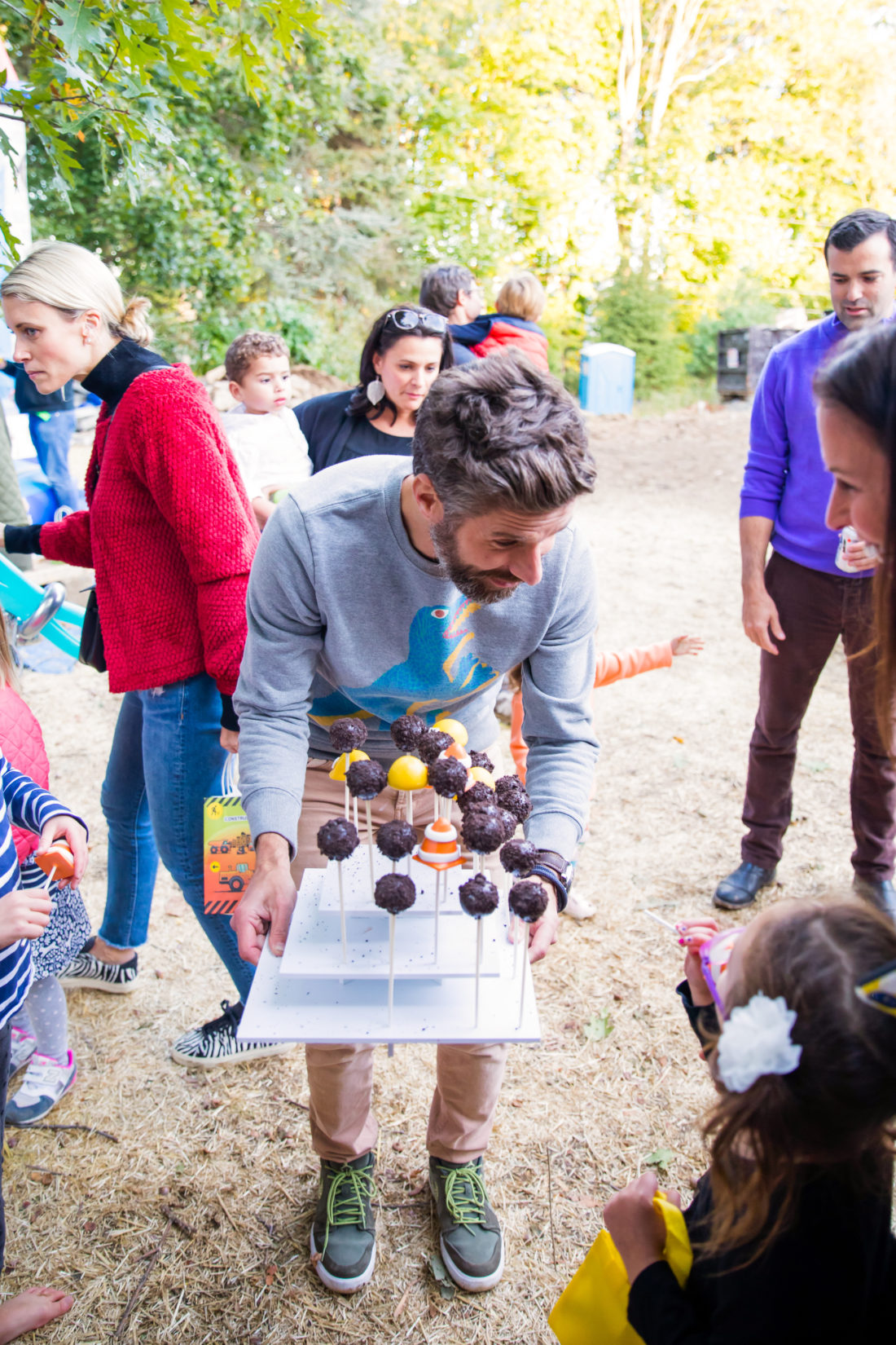 Kyle Martino offers partygoers Cake Pops at his son Major's Construction Zone themed birthday party